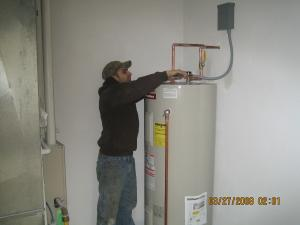 one of our Bowie water heater repair experets is repairing a broken unit